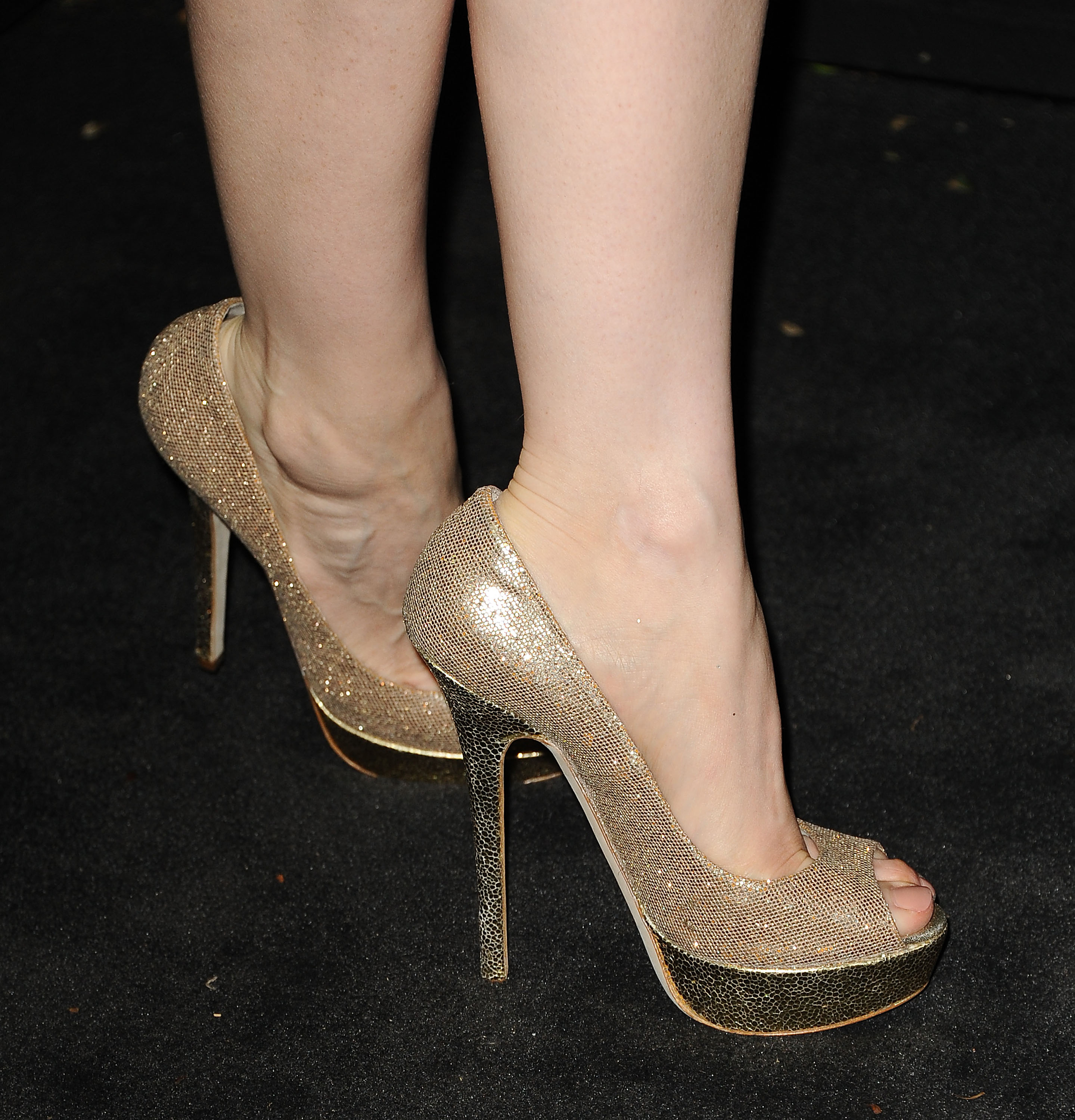 Jessica Chastain's gold glittery Jimmy Choo peep-toes add
