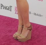 Nude platform sandals completed Mary Elizabeth Winstead's blue lace Emilio Pucci dress at the Spirit Awards.