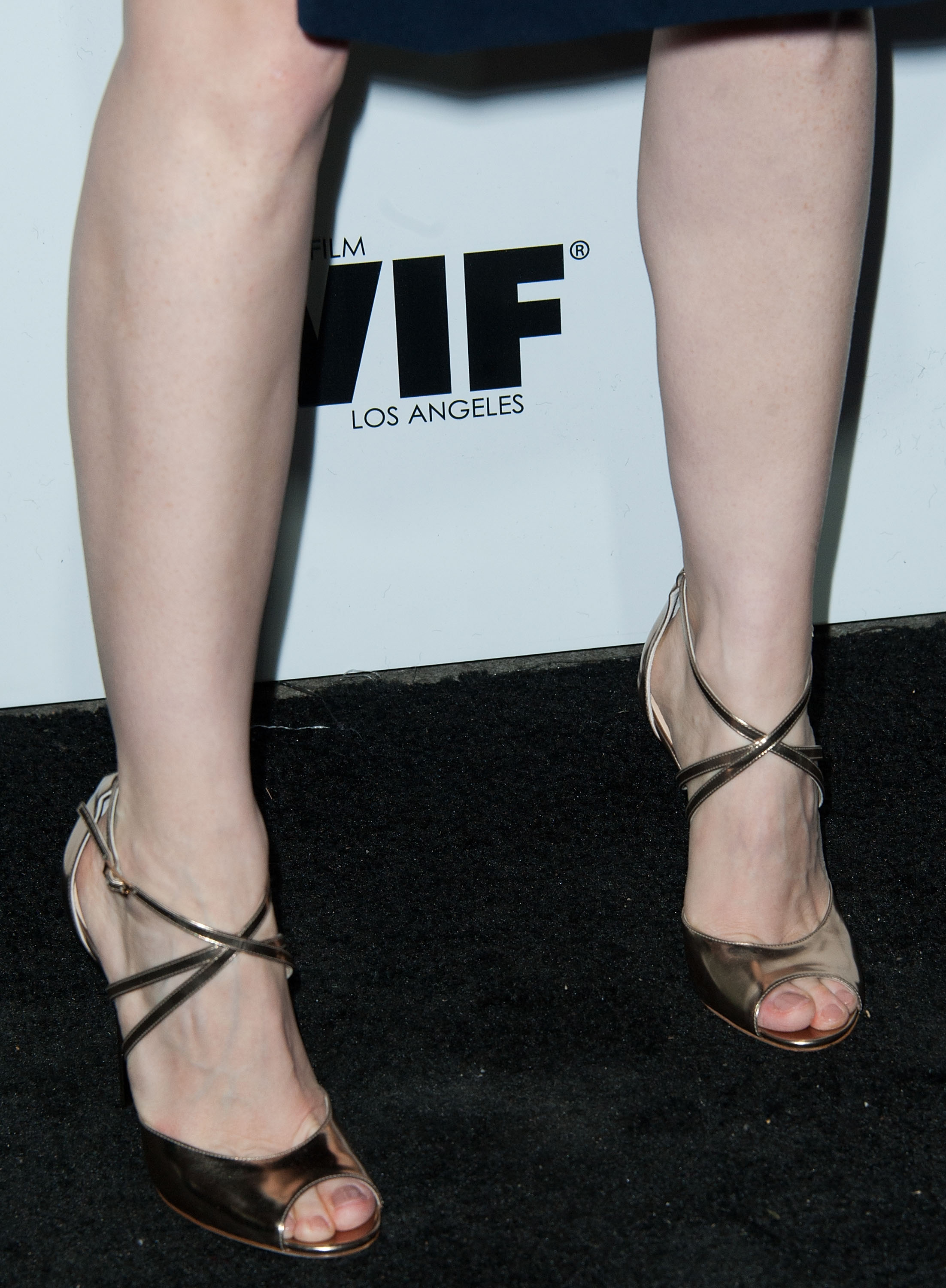 Jessica Chastain sported metallic Jimmy Choo sandals with a Preen dress at the Women in Film event.