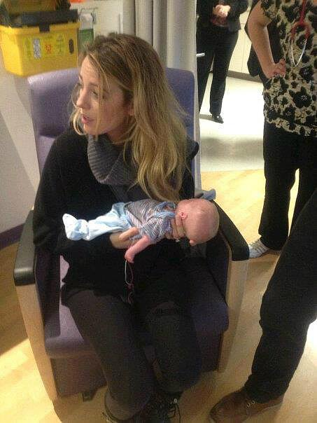 Blake Lively held a baby while visiting sick children at an Ontario hospital with her husband, Ryan Reynolds. Source: Facebook user Blake and Ryan Reynolds