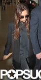 Victoria Beckham wore a black coat.