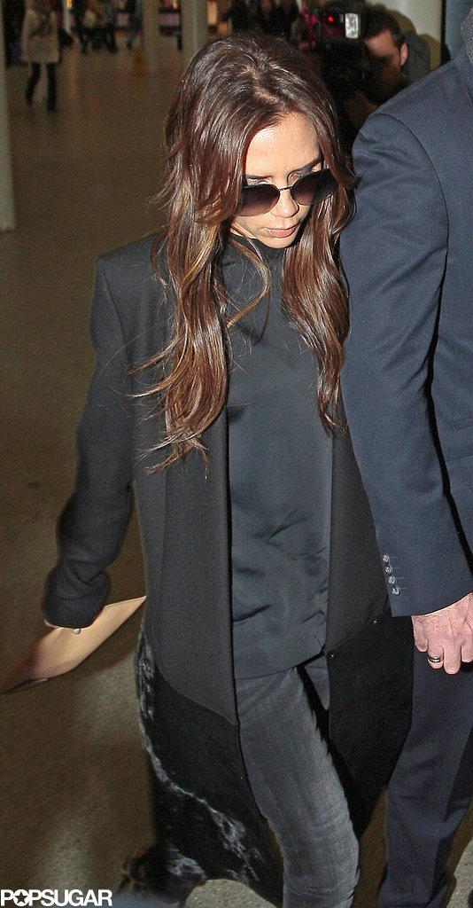 Victoria Beckham wore a black coat.
