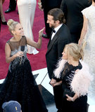 Kristin Chenoweth took a moment to talk to Bradley Cooper and his mom, Gloria, on the red carpet at the 2013 Oscars.