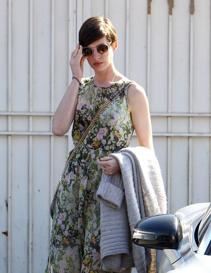 Anne Hathaway paired shades with her long floral dress.