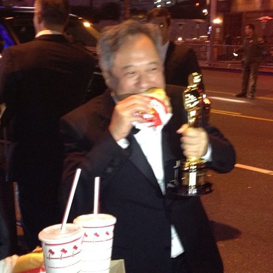 Best director winner Ang Lee ate an In-N-Out burger at the Vanity Fair Oscars party. Source: Instagram user vanityfair