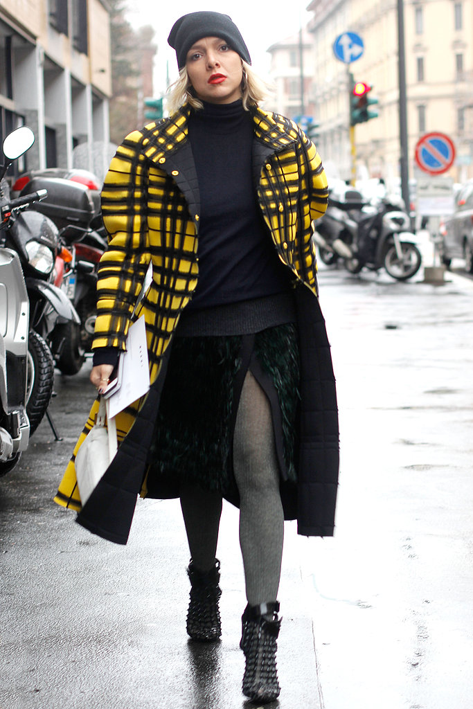 A bright yellow coat livened up the moody palette in this look.