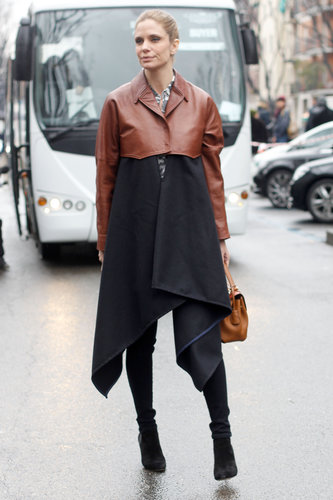 We love the unique feel of this leather topped coat with a floaty hemline.