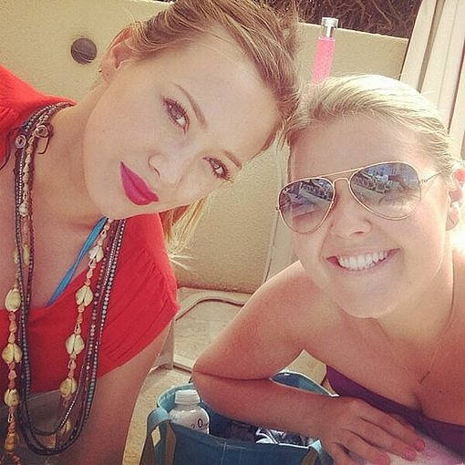 Hilary Duff spent time poolside with a friend. Source: Twitter user HilaryDuff