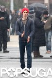 Andrew Garfield tried to stay warm on the set.