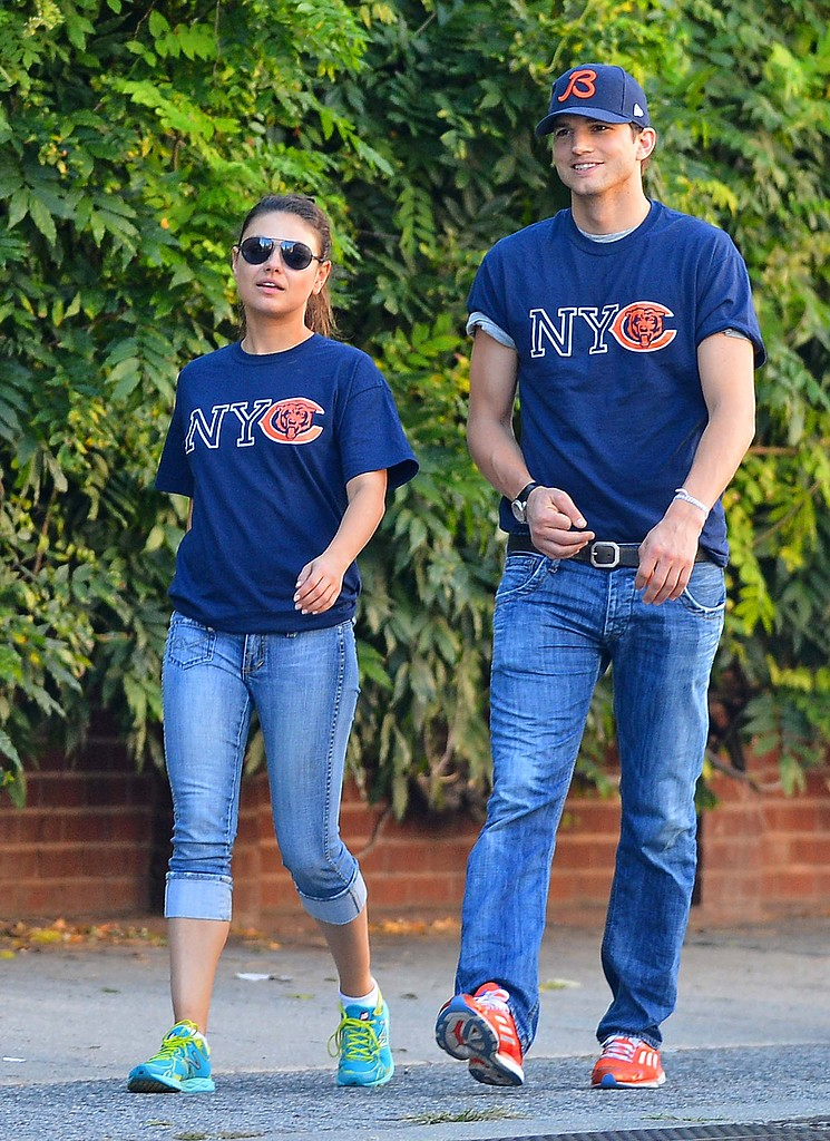 Ashton Kutcher convinced girlfriend Mila Kunis to cheer for his team as the two spent a day together in NYC in September 2012.