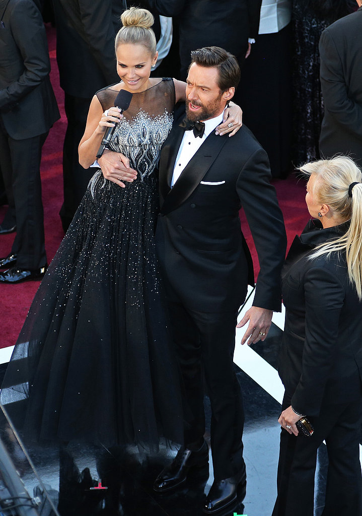 Hugh Jackman jokingly picked up Kristin Chenoweth at the Oscars.