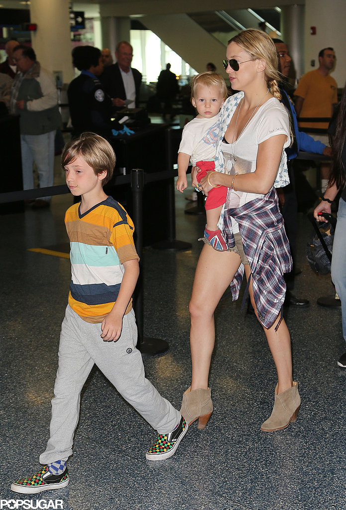 Kate Hudson carried Bing as Ryder led the way through the airport in Miami on Wednesday.
