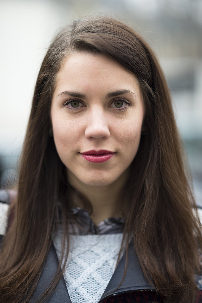 Laura Babin used a heavy hand with her mascara wand, pairing it with a glossy pink lip for the ultimate feminine facade.  Source: Le 21ème | Adam Katz Sinding