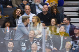 Kristen Bell puckered up to Dax Shepard at a hockey game while sitting next to Alyssa Milano and David Bugliari.