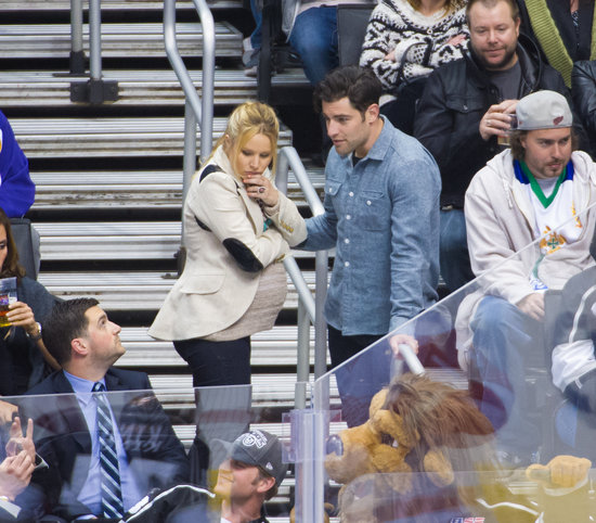 Kristen Bell chatted with Max Greenfield at the Kings game.