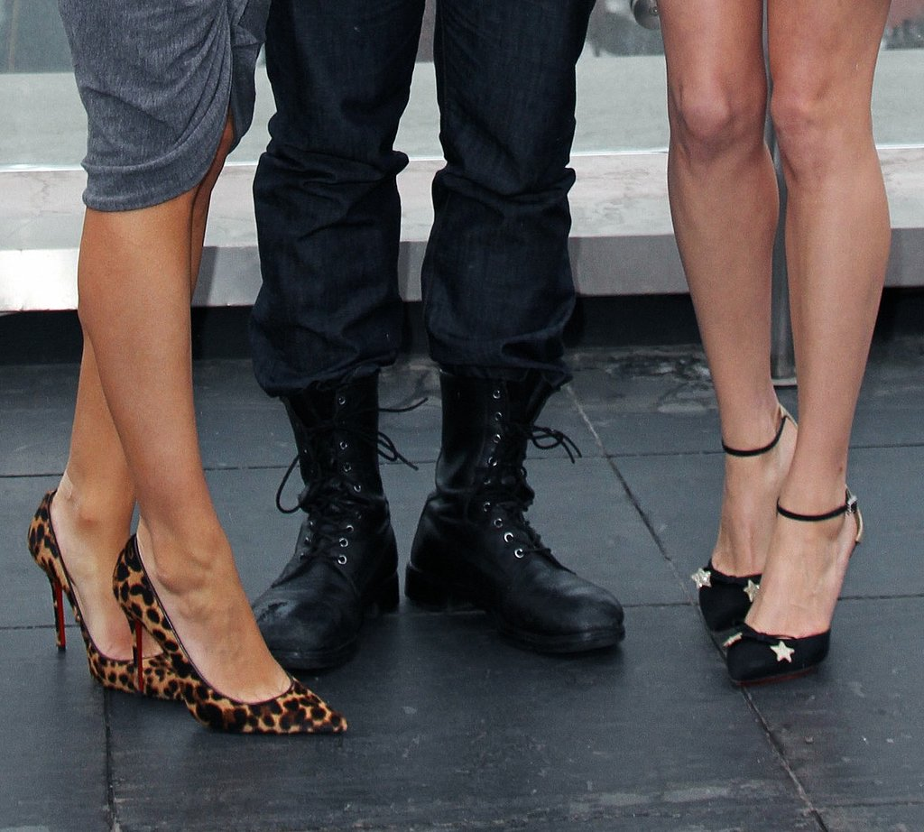 A zoomed-in view of Mila's Christian Louboutin leopard pumps and Michelle's Charlotte Olympia Astrid pumps.