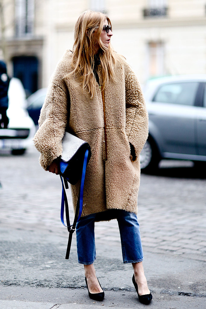 This fuzzy coat got a chic makeunder with a colorblock bag, slim denim, and classic pumps.