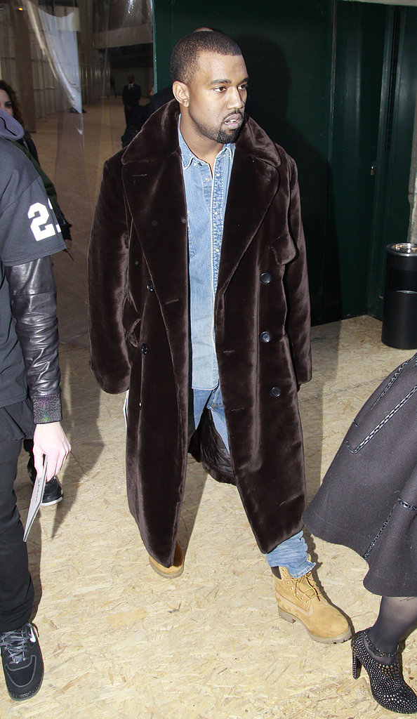 Kanye West covered up in fur for the Celine presentation on Sunday.