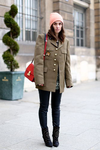 She softened up a military topper with a pastel beanie and cool-girl booties.