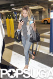 Lauren Conrad wore a scarf over her t-shirt as she arrived in Miami.