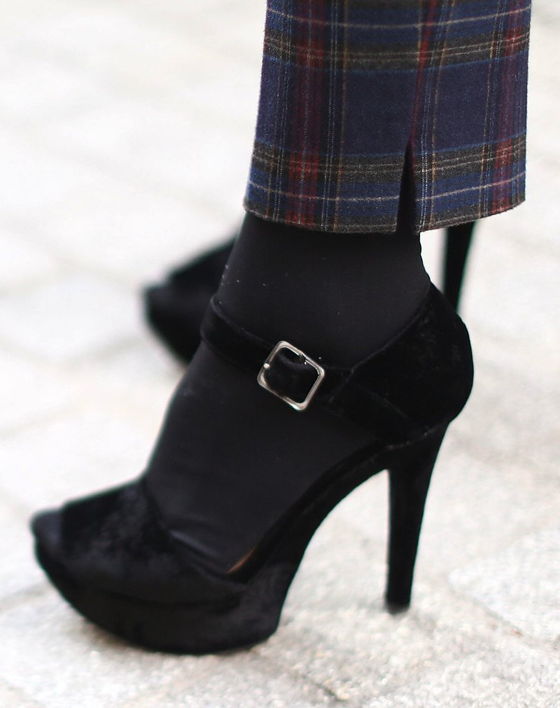 A pair of classic plaid trousers was updated with a pair of svelte platform sandals.