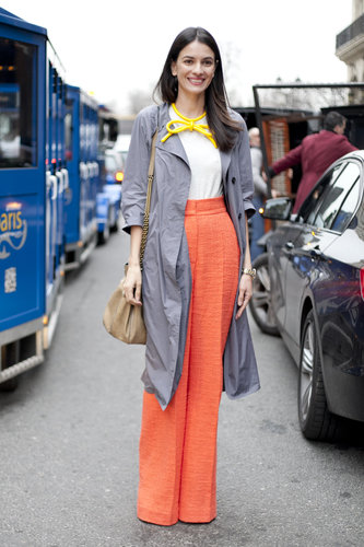 A bow-tied necklace married perfectly with the tangerine color of her trousers — equal parts ladylike and a little playful.