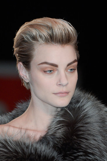 Jessica Stam had the distinct honor of being the only model on the runway not to wear the same hair look as everyone else. Her short hair was swept back to put the emphasis on the strong brows created for the show.