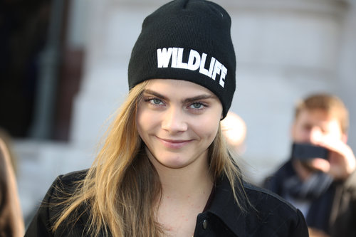 """Model Cara Delevingne wore a """"Wildlife"""" hat outside the Stella McCartney show in March during Paris Fashion Week."""