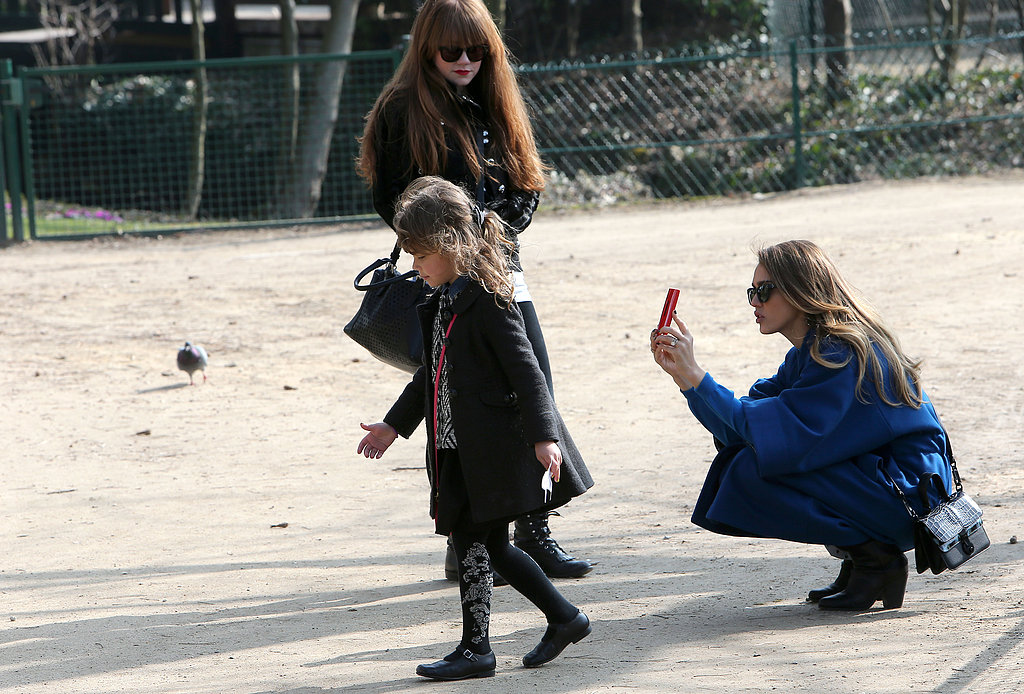 Jessica Alba took pictures of Honor as they entered the amusement park in Paris on Sunday.