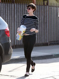 Anne Hathaway carried paper towels and cleaner in Venice, CA.