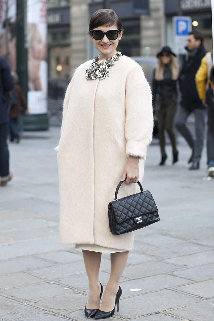 This attendee nailed vintage-feeling femininity in a car coat, classic Chanel, and oversize cat-eye frames.