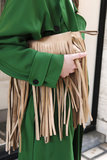 A camel-hued fringed clutch popped against a gorgeous grass-green coat.