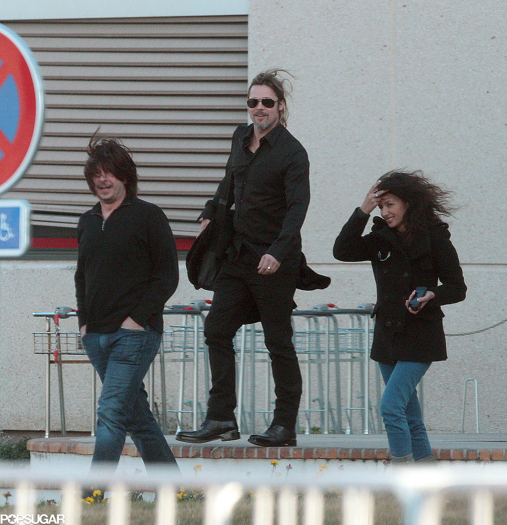 Brad Pitt and his friends smiled as the wind blew their hair around.
