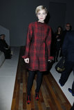 Jessica Stam attended Valentino in a plaid coat and matching red t-strap peep-toes.