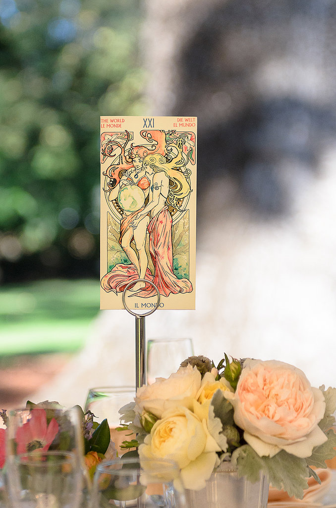 It's never too late for a personal touch! At the last minute, the bride used these vintage-print tarot cards for table numbers. Photo courtesy of Juliette Tinnus