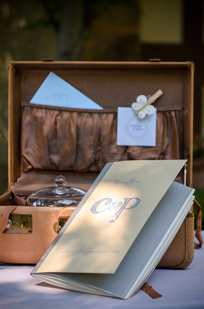 The groom worked with a designer to make a custom guest book that mimicked the vintage script and theme of the wedding. Photo courtesy of Juliette Tinnus