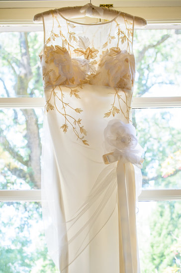 Rather than a color scheme or theme, Courtney's dress set the tone for the wedding. Inspiration from the dress's delicate deco touches began the planning process.  Photo courtesy of Juliette Tinnus