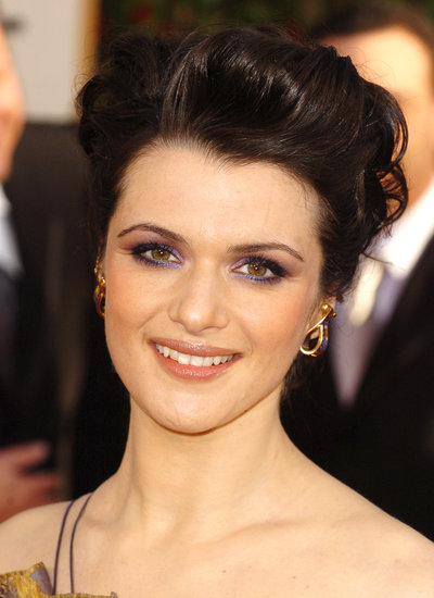 For the 2006 Golden Globe Awards, Rachel walked the red carpet with a voluminous updo coupled with shimmering purple eye makeup.