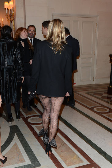 Kate Moss showed major skin in her sheer Saint Laurent bodysuit on Tuesday.