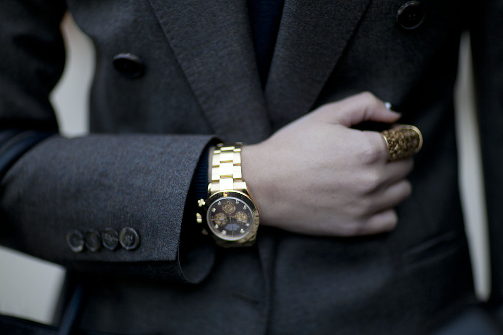 A gold watch and bold statement ring completed this menswear-inspired look.