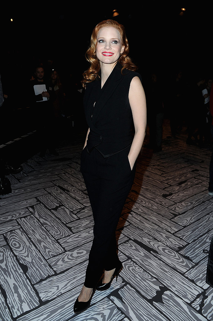 At Viktor & Rolf, Jessica Chastain stuck to dark hues in a black jumpsuit by Viktor & Rolf and black pumps.