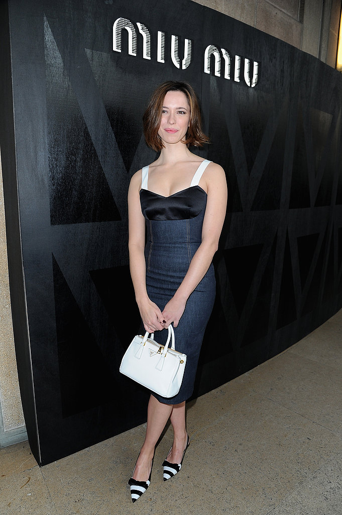 Rebecca Hall donned a bustier-style denim Prada dress with striped Prada pumps and a white Prada bag at Miu Miu's show.