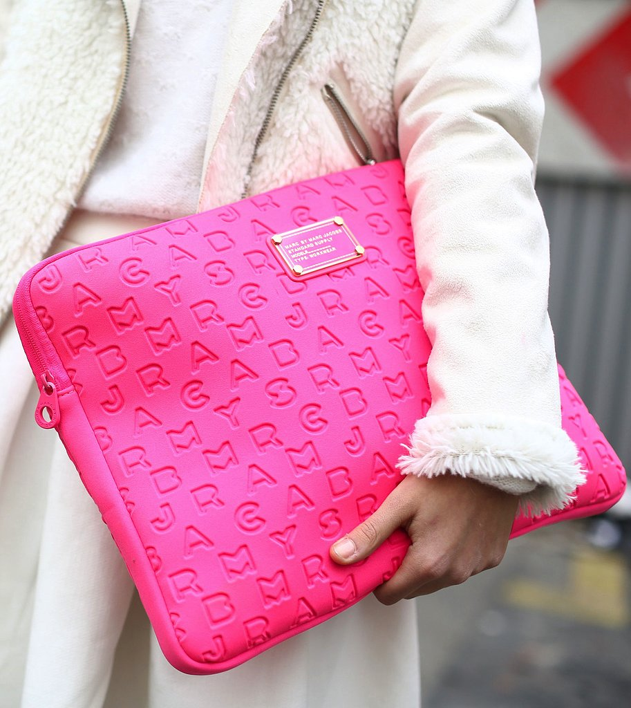 A hot-pink Marc by Marc Jacobs laptop sleeve doubled as a chic clutch.