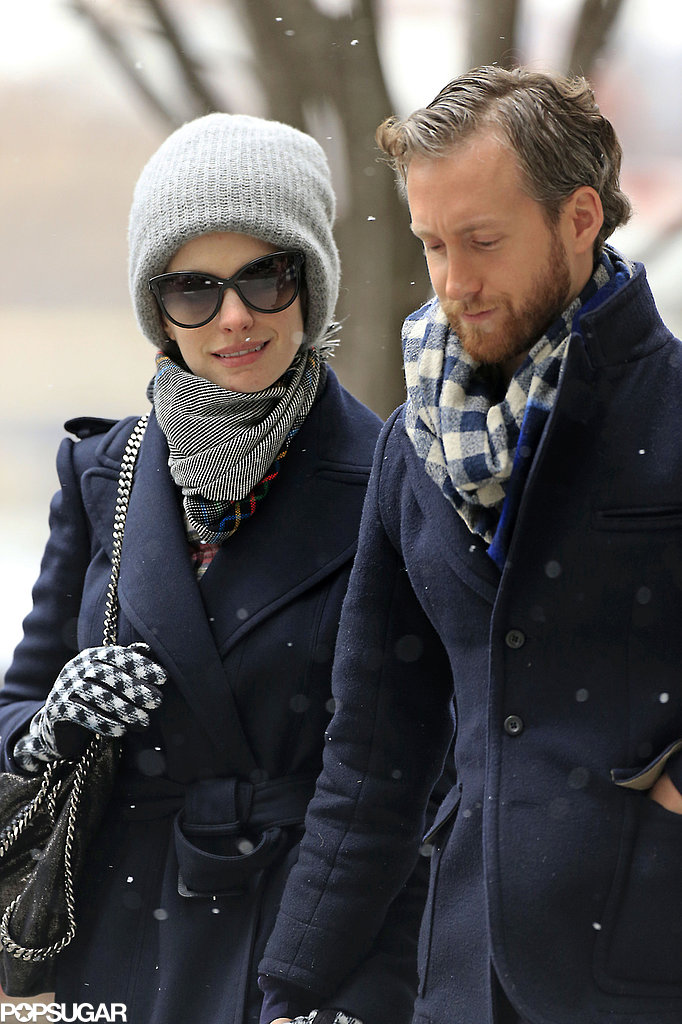 Anne Hathaway and Adam Shulman bundled up during a snowy stroll in NYC on Thursday.