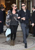 Kate Moss and Jamie Hince left their Paris hotel arm in arm after wrapping up Fall fashion week in March 2013.