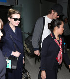 Kirsten Dunst and Garrett Hedlund had an airline escort walk them through the terminal in LA on Wednesday.
