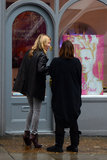Kate Moss admired a painting of herself.