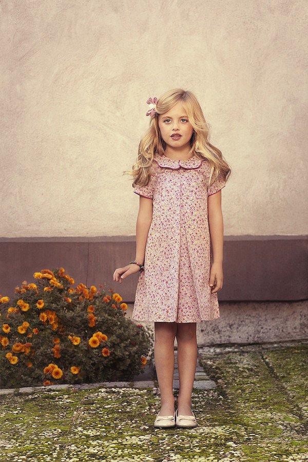 """""""Emi's"""" Pink Rosebud Party Dress ($150) was designed for the warm and friendly 6 year old who resides in Tokyo and has a passion for animals and wildlife."""