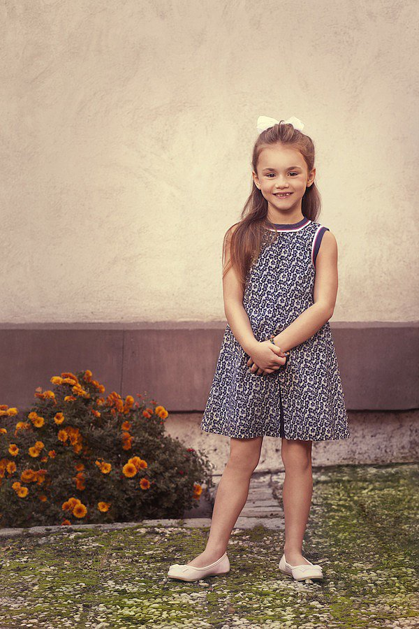 """The Navy Floral Print Dress ($138) was made with """"Scarlet,"""" a 5-year-old Texan, in mind. The precocious tot romps with her older brothers, and dreams of being an actress when she grows up!"""