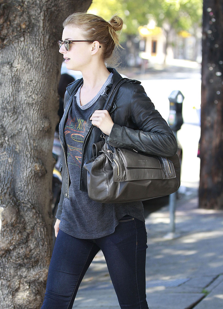 Emily VanCamp carried a cute black purse and wore her hair in a bun.